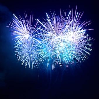 Blue fireworks at night