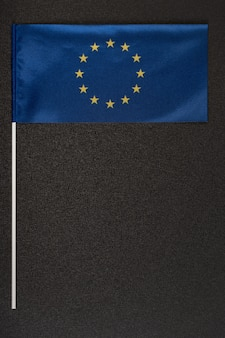 Blue flag of the european union on grey background