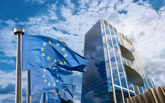 Blue flag of the european union with bitcoin icons and a modern building in the form of a symbol of