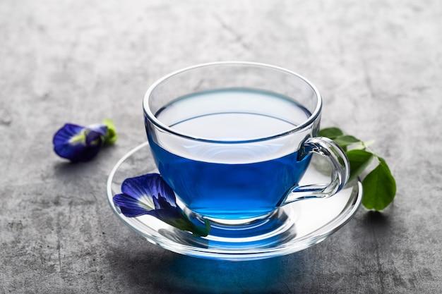 Blue flower tea of butterfly pea on grey