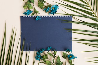 Blue flowers and notepad