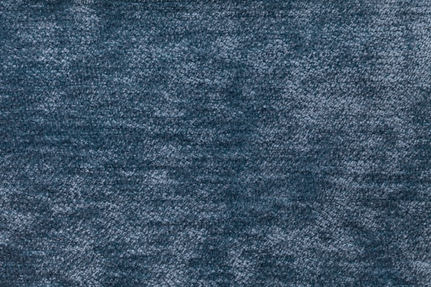 Blue fluffy background of soft, fleecy cloth. texture of textile closeup