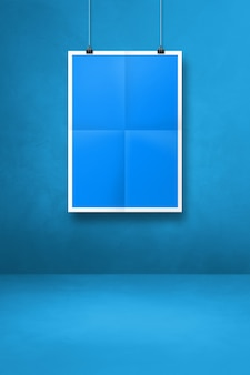 Blue folded poster hanging on a clean wall with clips. blank mockup template