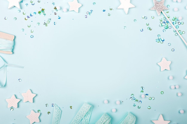 Blue frame background with stylish decoration stars and sequins with copy space for text.  flat lay, top view