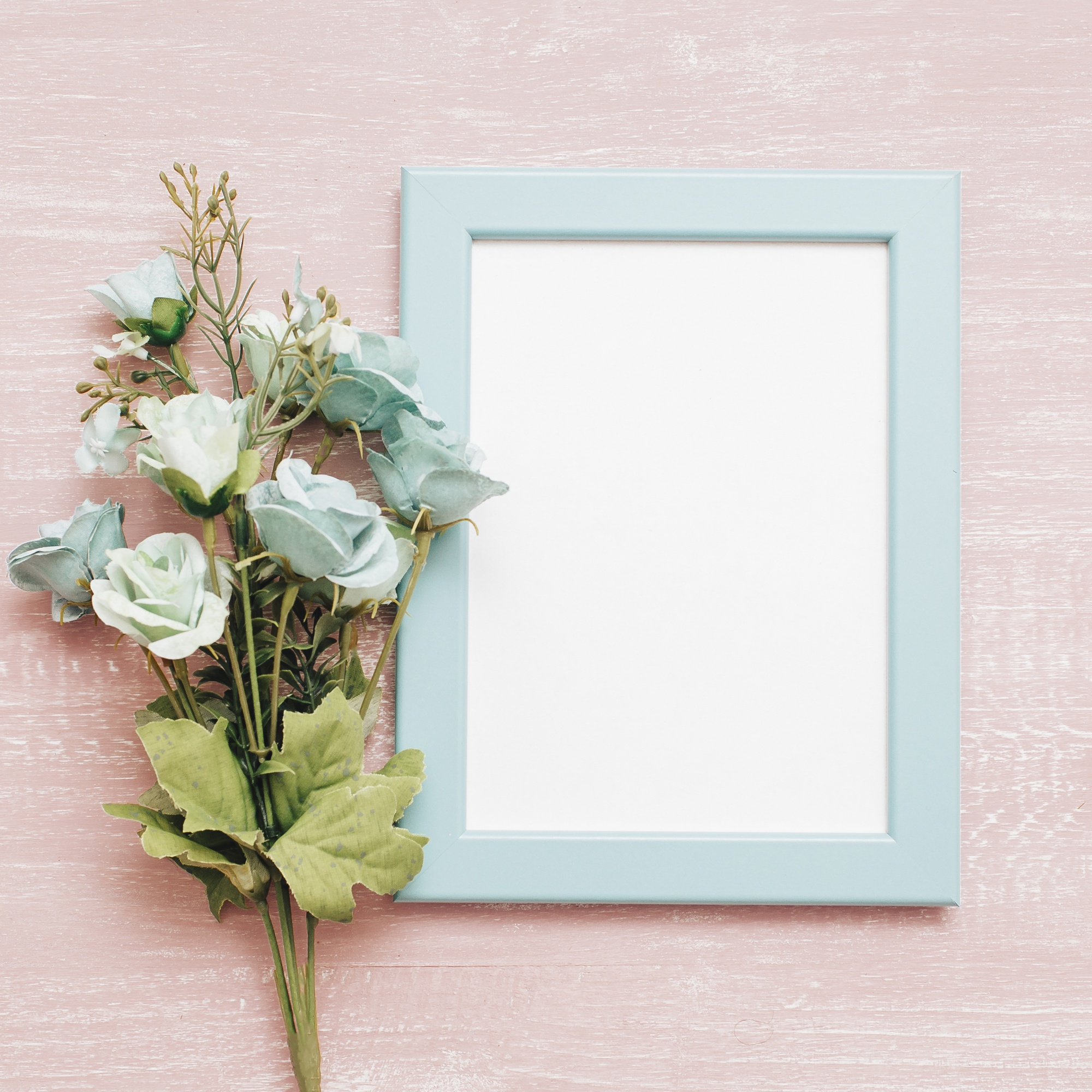 Blue frame with bouquet of peonies