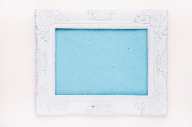 Blue frame with white wooden border isolated on white backdrop