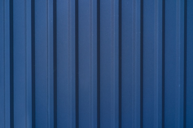Blue galvanized tin fence lined background. metal texture