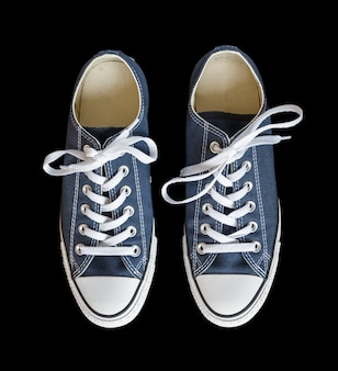 Blue generic sneakers isolated on black