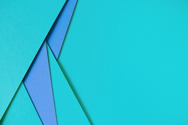Blue geometric composition paperboard background with copyspace