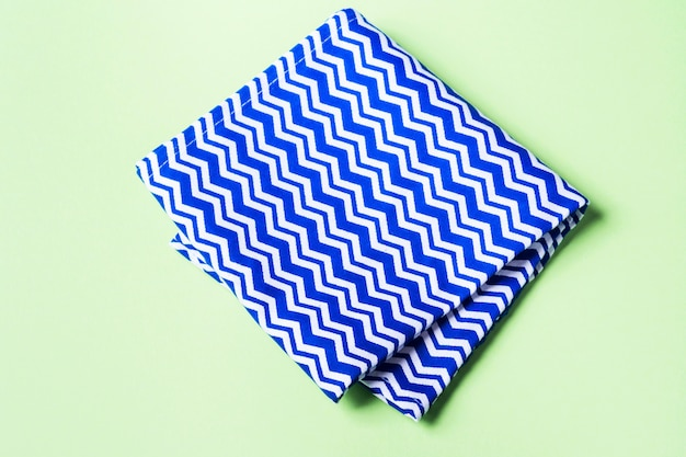 Blue geometrical napkin on pastel green