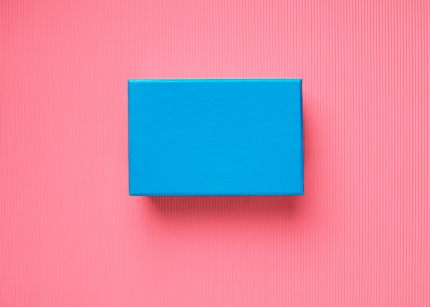 Blue gift box on pink coral