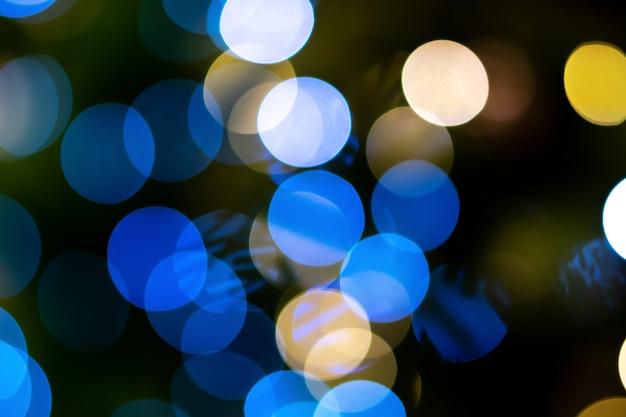 青いキラキラボケ背景。抽象的な青いボケ味の背景。スペースをコピーします。