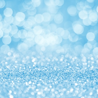 Blue glowing particles bokeh square display background