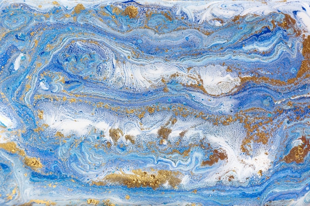Blue and gold marbling. golden marble liquid texture.