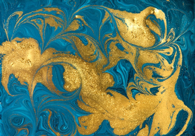 Blue and gold marbling pattern. golden marble liquid texture.