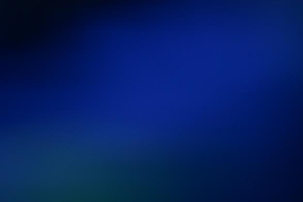 青いグラデーションの焦点がぼけた抽象的な写真の滑らかな線の色