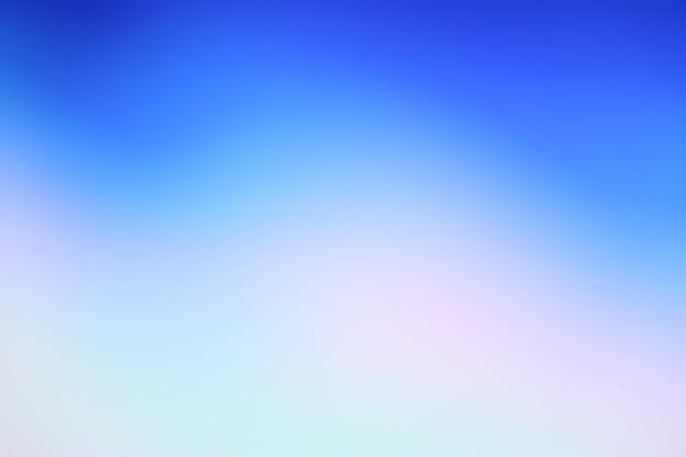 青いグラデーションの焦点がぼけた抽象的な写真の滑らかな線