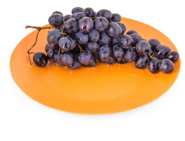 Blue grapes in a clay plate