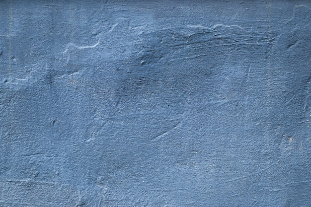 Blue and gray concrete texture, rough painted background. grunge architecture backdrop. uneven solid surface.