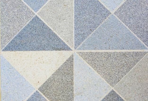 三角形のパターンを持つ青灰色の大理石のデザイン。背景と質感