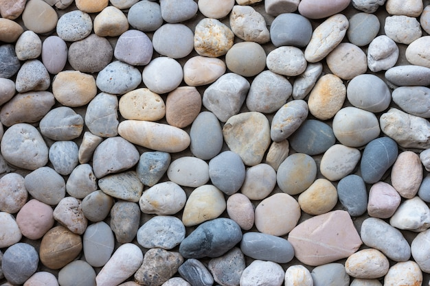 Blue and gray sea pebble stone wall texture background.