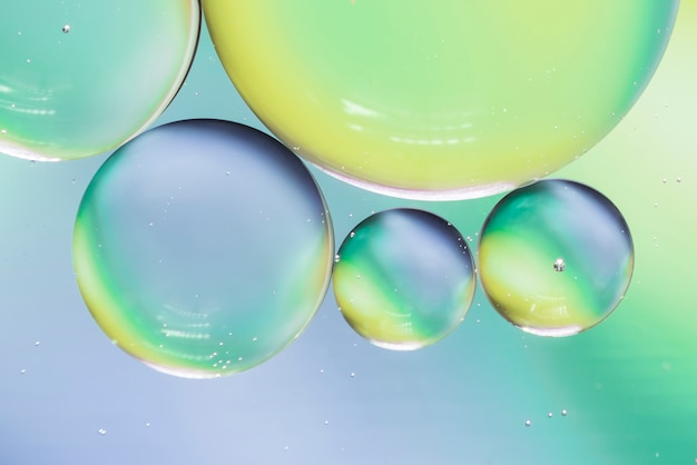 Blue and green abstract background with bubbles