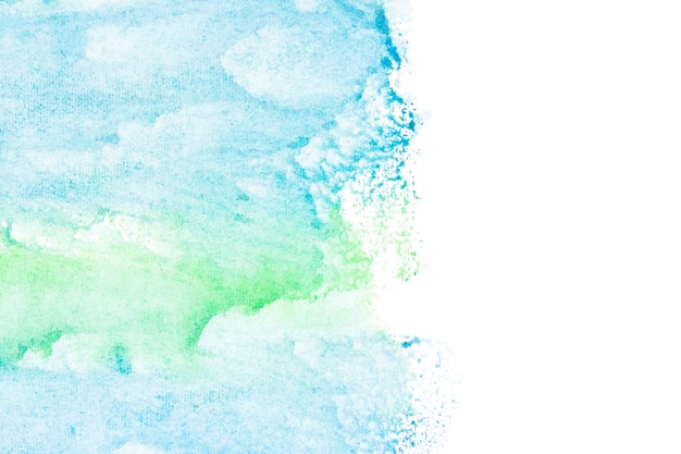 Blue and green paint strokes on white background