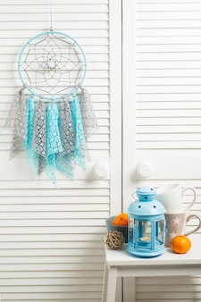 Blue grey dream catcher with crocheted doilies