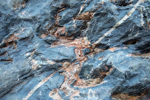 青灰色オレンジ色の岩の構造、背景のテクスチャ
