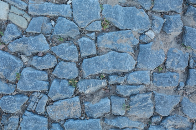 Blue and grey texture of the stone wall. old vintage bridge background
