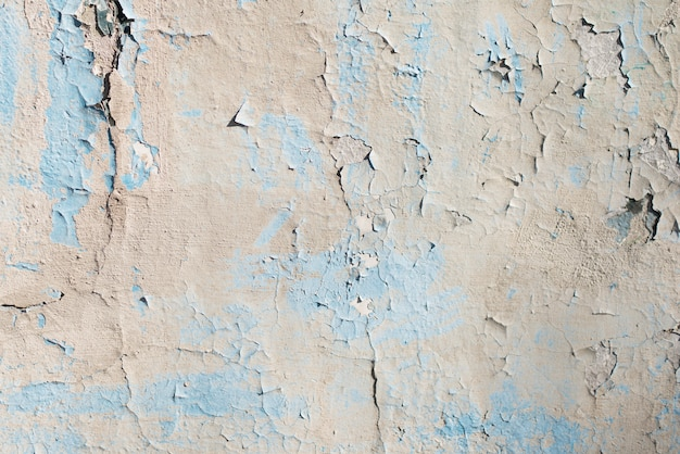 Blue and grey texture with scratches and cracks. blue background. blue and grey pattern.light wall