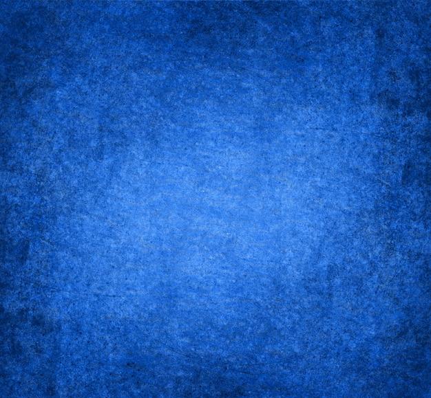 テキストまたは画像用のスペースと青いグランジ背景
