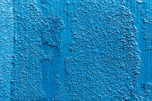 Blue grungy wall texture background with copy space