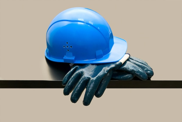 Blue hardhat and  leather gloves