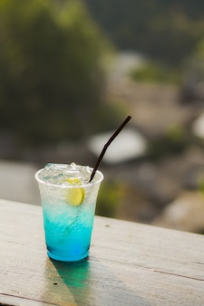 Blue hawaii drink with lemon in afternoon