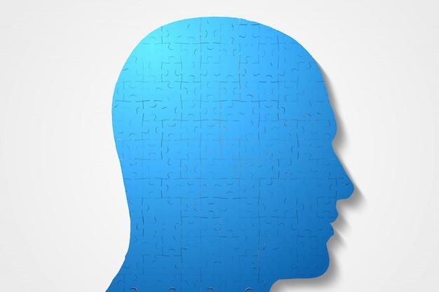 Blue head made of jigsaw pieces