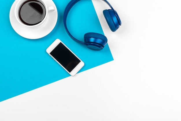 Blue headphones on blue and white color background