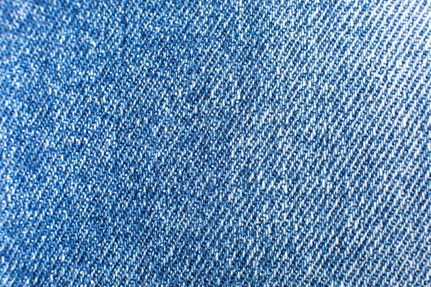 Blue hipster jeans material. denim cloth texture background.