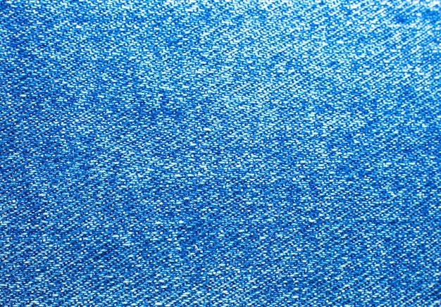 ブルーのヒップスタージーンズ素材。デニムクロスのテクスチャ背景。