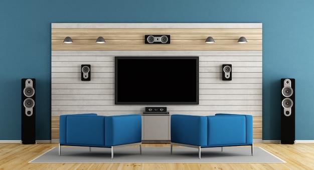 평면 tv와 파란색 안락 의자가있는 블루 홈 시네마