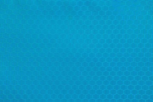 블루 벌집 배경 텍스처입니다. 폴리 에스터 직물의 질감 배경입니다. 플라스틱 직조 패브릭 패턴