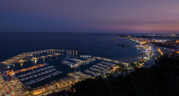 Blue hour at the mediterranean coast of blanes in catalonia, spain.