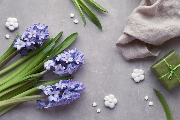 Blue hyacinth flowers on light stone background, top view
