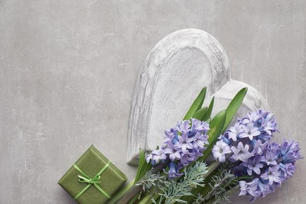 Blue hyacinth flowers on light stone