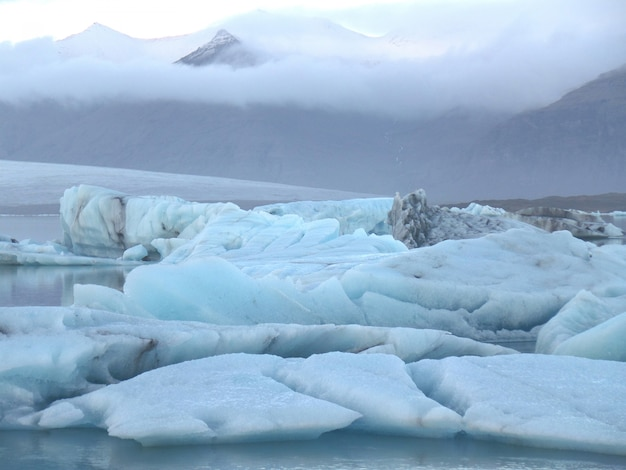 Blue icebergs floating in jokulsarlon glacier lagoon, south iceland