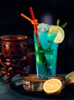 Blue iced cocktail with lemon slice