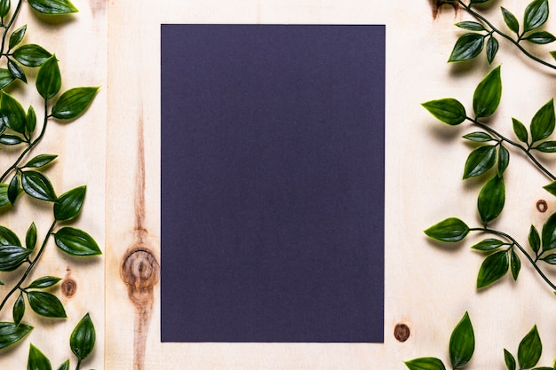 Blue invitation on wooden background