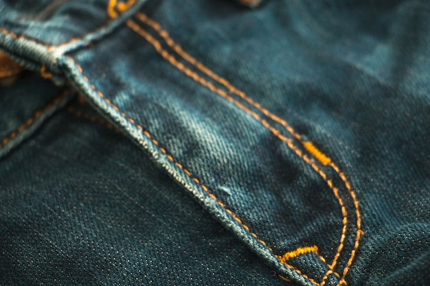 Blue jean background, denim with seam texture of fabric.