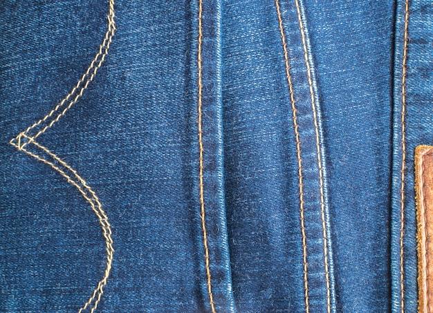 Синие джинсы и швы текстуры. джинсовый фон со швом