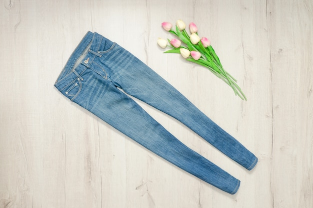 Blue jeans and bouquet of tulips. fashionable